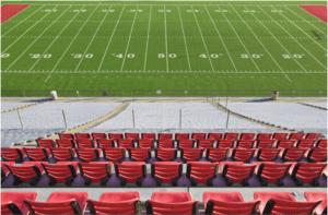 Empty Football Field and StadiumSeats